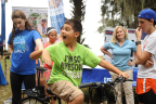 """Alachua County 4-H Members use a smoothie bike to create their own healthy snack in return for a little """"sweat equity"""" at the annual """"Little Run on the Prairie"""" 5K race at Payne's Prairie Preserve State Park in Micanopy, Fl. The smoothie-bike is part of $40,000 grant announced today from UnitedHealthcare to University of Florida's Institute of Food and Agricultural Sciences (IFAS) that will promote healthy living among youth. (Photo credit: Julie Brewer Photography)"""